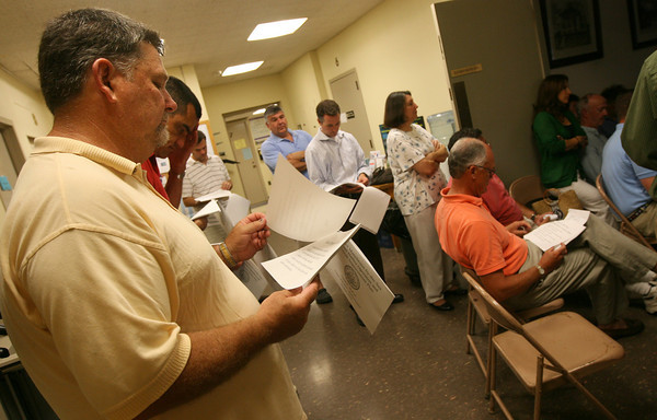 Manchester: A dozen people stand in the hallway at Manchester Town Hall outside the selectmen's meeting at Town Hall on Tuesday night. The agenda was focused on the town's mooring problems. Photo by Kate Glass