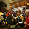 Manchester: Nicholas Lopardo, 8, and Gus Brown, 9, wait for an autograph from the Boston Bruins mascot, Blades, at the Manchester Public Library yesterday afternoon. Photo by Kate Glass/Gloucester Daily Times
