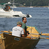 Gloucester: John Scola and Mike Harmon, front, let their boat drift into Nile Beach after winning their race against Chris Ferrante and Bill Edmonds during the International Dory Race Elimination races Saturday morning. Mary Muckenhoupt/Gloucester Daily Times