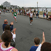 Gloucester: The crowd applauds runners as they approach the finish line on Western Avenue during the first Run Gloucester! 7-mile road race yesterday morning. Photo by Kate Glass/Gloucester Daily Times