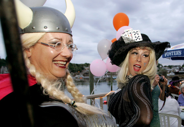 "Gloucester: Dale Grasso, right, turns for a photo while standing next to Sabine Ocker at the ""Dudes and Divas"" themed Beaux Arts Costume Ball at The Studio on Rocky Neck Thursday night.  The evening included, food, a silent auction and dancing to raise money for the Rocky Neck Art Colony. Mary Muckenhoupt/Gloucester Daily times"