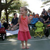 Essex: Lucy Camera-Murray claps to the music during the 17th Essex Music Festival at Centennial Grove Saturday afternoon. Lucy had fun making friends and running aorund to the music. Mary Muckenhoupt/Gloucester Daily Times