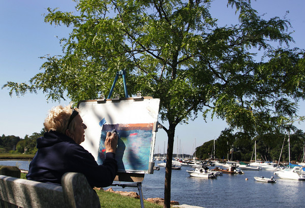 Manchester: Evelyn Carnevale uses pastels to sketch Manchester harbor with an art class run by Elizabeth Clark of Manchester Saturday morning.  Every Saturday the students come to sit by the water by Masconomo Park take advantage of the nice weather. Classes in the winter must be held indoors. Mary Muckenhoupt/Gloucester Daily Times