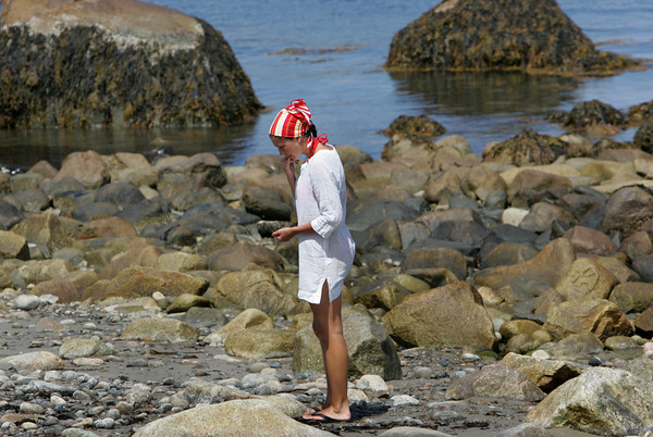 Rockport: Francesca Erigo keeps an eye out for seaglass in the rocks at Back Beach Saturday afternoon. Erigo said you have to really look hard for the seaglass because it tends to be hidden between the rocks. Mary Muckenhoupt/Gloucester Daily Times