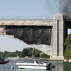 Gloucester: The U.S. Coast Guard prevented boat traffic from passing beneath the A. Piatt Andrew Bridge due to a fire burning underneath the bridge. Route 128 was closed while the fire was extinguished, backing up traffic for miles. Photo by Kate Glass/Gloucester Daily Times