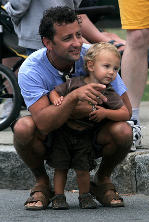 Gloucester: Joseph Loiacano of Gloucester points out some of the runners to his son, Joseph, 2, at the start of Run Gloucester! yesterday morning. Photo by Kate Glass/Gloucester Daily Times