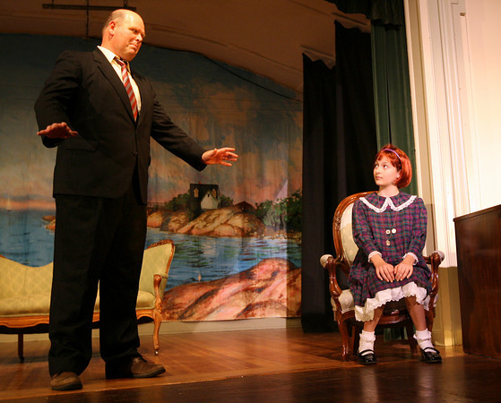 "Gloucester: Mike English as Oliver Warbucks and Julia Silveira as Annie rehearse a scene from the Annisquam Village Players performance of ""Annie,"" which runs Tuesday through Sunday at the Annisquam Village Hall. Photo by Kate Glass/Gloucester Daily Times"