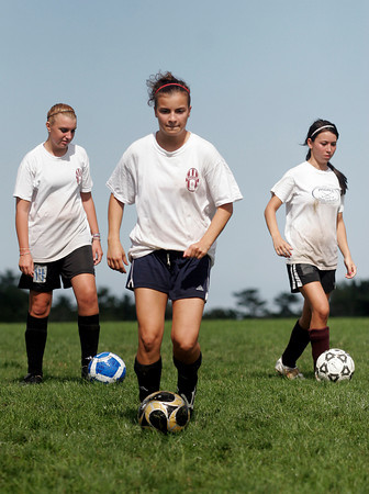 Gloucester: Gloucester girls soccer captain Stephanie Kelley works on a dribbling drill during practice at Magnolia Woods yesterday. Photo by Kate Glass/Gloucester Daily Times