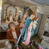 Gloucester: Katie Fontanna makes some adjustments to the Mother of Grace statue at the Mother of Grace Club Friday morning.  Fontana, who is the president of the Mother of Grace Club, was getting ready for the novena that begins Thursday for the 66th annual Mother of Grace Club Fiesta.  Mary Muckenhoupt/Gloucester Daily Times