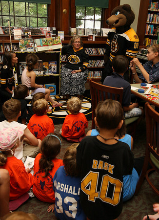 "Manchester: Sara Collins, the Children's Librarian at the Manchester Public Library, reads ""Casey and Derrek on the Ice,"" which was donated to the library by the Boston Bruins yesterday afternoon. Photo by Kate Glass/Gloucester Daily Times"