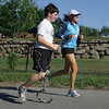 "Manchester: Brendan Driscoll of Essex goes for a run with his trainer Nan Gorton down the street from the Manchester Athletic Club Wednesday afternoon.  Driscoll was born missing his lower left leg, but thanks to grants, training clinics, and mentorship from the Challenged Athletes Foundation Brendan is now enjoying his 4th season of youth triathlon competing with able bodied kids and working to get the word out to other amputee kids to come on out and ""TRI"".  Brendan will be in 7th grade at Manchester Essex Middle School where he plans to go out for the Cross-country and Swim teams this year. Mary Muckenhoupt/Gloucester Daily Times"