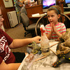 Manchester: Paula Galvin helps Ava Pick, 6, make a frog out of clay at the Manchester Library on Tuesday afternoon during a program with Ann McCrea. Photo by Kate Glass/Gloucester Daily Times