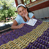 Manchester: Mackenzie Plante, 11, of Gloucester has started her own business making mats out of olf fishing rope.  Here she is pictured with the mats she sells at Utopia Farms in Manchester. Mary Muckenhoupt/Gloucester Daily Times
