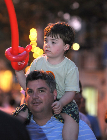Gloucester: Aiden Brown5, of Manchester takes in the sights and sounds at the Annual Block Party, while sitting on his fathers shoulders Saturday night on Main St.   Desi Smith /Gloucester Daily Times. August 20,2011