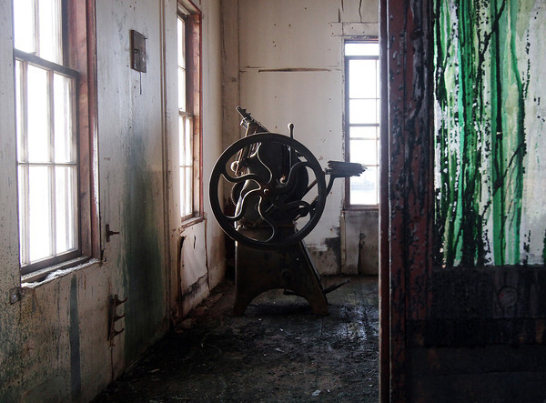 David Le/Gloucester Daily Times. A heavily stained, paint-streaked door opens to reveal an old paint processing room in the upstairs of the Paint Factory on Rocky Neck. 8/17/11.
