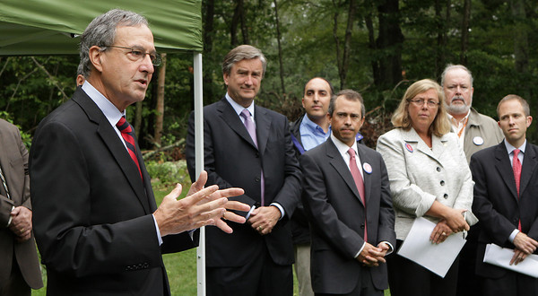David Le/Gloucester Daily Times. Jeffrey Simon, Director of the Massachusetts Recovery and Reinvestment Office addresses a small crowd gathered outside Stephanie East's House on Tuesday morning. Ms. East's house was the 10,000th residence that was weatherized by the Recovery and Reinvestment Act. From left, Simon is joined by Congressman John Tierney, Greg Verga, Ward 5 Councilor, Secretary Jay Gonzalez, Carolyn Kirk, Mayor of Gloucester, Paul McGeary, Ward 1 Councilor, and Mark Silvia, Head of the Department of Energy Resources. 8/16/11.