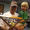 """Jeff Morin and his son, Nathan, 2, check out a display of butterflies at the Sawyer Free Library yesterday morning during the program, """"Butterflies with Kim Smith."""" Photo by Kate Glass/Gloucester Daily Times"""