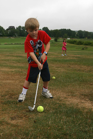 Elliott Thompson, who turns 6 at the end of the month, practices driving a tennis ball during the Bass Rocks Junior Clinic at the Bass Rocks Golf Course yesterday morning. Photo by Kate Glass/Gloucester Daily Times