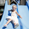 David Le/Gloucester Daily Times. Alexia Spinelli, 4, of Brookline, gimmaces as she slides down at Masconomo Park in Manchester on Wednesday afternoon. 8/17/11.