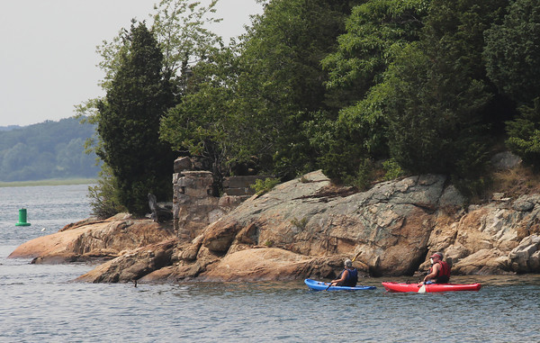 Essex: Two kayakers paddle around near Conomo Point. Photo by Kate Glass/Gloucester Daily Times