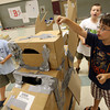 From right: Jackson Renda, Tres Morrell, and John Paul Penaloza construct a dragon from cardboard boxes during the Rockport Summer Fun program. Photo by Kate Glass/Gloucester Daily Times