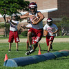 David Le/Gloucester Daily Times. Gloucester High School senior Kyle Lucido, leaps over a few obstacles in an agility drill at the first practice of the year for the Gloucester football team. 8/22/11.