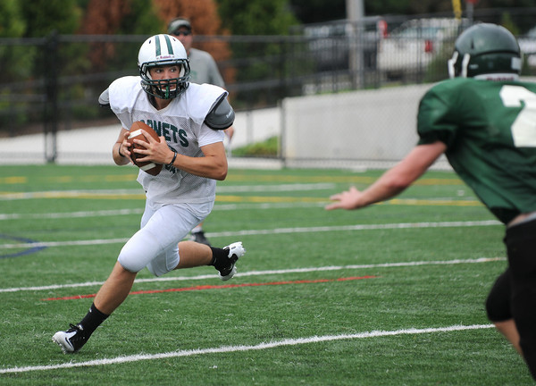 Manchester: Manchester's QB player looks to pass during a scrimmage game Saturday morning against Pentucket at MERHS. Desi Smith /Gloucester Daily Times. August 28,2011.