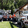 A crew gathered at the end of Rockholm Road in Annisquam to discuss how to restore power to over 28 homes in the area that were still without power on Tuesday afternoon. David Le/Gloucester Daily Times