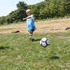 Gloucester: Mac Trotman, right, scores a goal as his teammate, Peter Giordano, looks on during the North Shore United Soccer Clinic at Magnolia Woods yesterday. The clinic, which is for kids age 6-14, runs all week. Photo by Kate Glass/Gloucester Daily Times