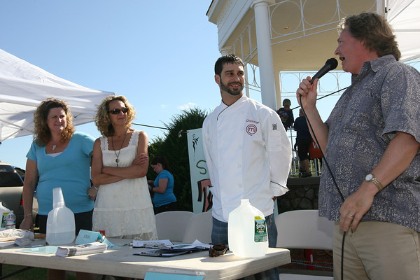 "Peter van Ness interviews ""MasterChef"" contestant Christian Collins, food writer Heather Atwood, and Laurie Lufkin, who has won numerous cooking contests, as they prepare to judge the Seafood Throwdown at the Cape Ann Farmer's Market yesterday. Amelia's Restaurant narrowly defeated the Breakfast Cafe at the Atlantis Ocean Front Inn. Photo by Kate Glass/Gloucester Daily Times"