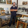 David Le/Gloucester Daily Times. Ken Knowles, a local artist from Rockport stands with many of his paintings that he will put on display at the North Shore Arts Association. 8/17/11.