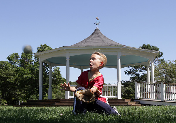 David Le/Gloucester Daily Times. Nick Brunning, 6, of Manchester, winces as he prepares to catch a ball thrown by his father at Masconomo Park on Monday afternoon. 8/23/11.