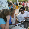 """MasterChef"" contestant Christian Collins, food writer Heather Atwood, and Laurie Lufkin, who has won numerous cooking contests, discuss the dishes created for the Seafood Throwdown at the Cape Ann Farmer's Market yesterday. Amelia's Restaurant narrowly defeated the Breakfast Cafe at the Atlantis Ocean Front Inn. Photo by Kate Glass/Gloucester Daily Times"