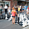 Gloucester:  Many passerby's stop to watch or play a game of street chest ,as they make thier way down Main St at the Annual Block Party Saturday night.    Desi Smith /Gloucester Daily Times. August 20,2011