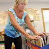 Marla Polizzia, a Kindergarten teacher at Beeman Elementary School, organizes some books in her classroom in preparation for the first day of school on Wednesday. David Le/Gloucester Daily Times