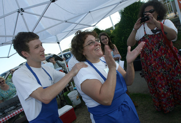 Steve Ferrant and Amelia Lopes of Amelia's Restaurant celebrate their win in the Seafood Throwdown at the Cape Ann Farmer's Market yesterday. Photo by Kate Glass/Gloucester Daily Times