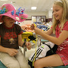 Naomi Woodson and Rosie McNiff make dolls using clothespins at the Rockport Recreation Department's Summer Fun program. Photo by Kate Glass/Gloucester Daily Times