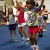 Kaitlin Rattray practices her tuck jump during GHS Cheerleaders Mini Camp at the Benjamin A. Smith Fieldhouse yesterday. The camp, which is for kids age 5-11, runs through Thursday. Photo by Kate Glass/Gloucester Daily Times