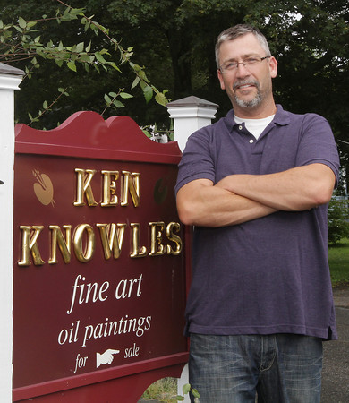 David Le/Gloucester Daily Times. Ken Knowles, a local artist from Rockport stands outside his studio. Knowles will have a reception for his new show at the North Shore Arts Association on August 26th. 8/17/11.