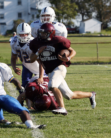 Gloucester high school running back Mark Horgan cuts through the St. John's Prep defense during their scrimmage on Tuesday. David Le/Gloucester Daily Times