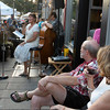 Gloucester: Jack Reynolds and Alison Rowell enjoy a glass of wine,as they listen to local singer Linda Amero, Bronek Suchanek and Jack Senier in front of the Franklin Club on Main St at the Annual Block Party Saturday night.   Desi Smith /Gloucester Daily Times. August 20,2011