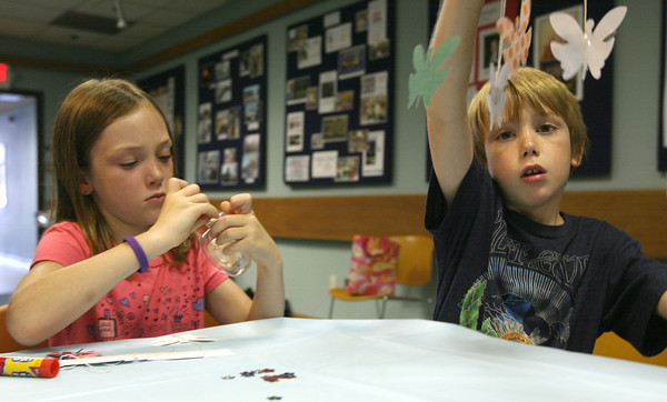 Ava Hale, 8, and her brother, Haden, 7, make butterfly mobiles at the Sawyer Free Library during Butterflies with Kim Smith on Wednesday. Photo by Kate Glass/Gloucester Daily Times
