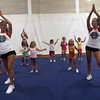 Gloucester High School cheerleaders Jenny Nugent and Lexie Lococo demonstrate a dance routine for their group of young cheerleaders during GHS Cheerleaders Mini Camp at the Benjamin A. Smith Fieldhouse yesterday. The camp, which is for kids age 5-11, runs through Thursday. Photo by Kate Glass/Gloucester Daily Times