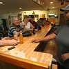 Bartender Shaquitta Leday serves Jerry Olson a beer as Sheryl Hansen and Sandra Kee look on at the American Legion. The Legion's members lounge has reopened for members and guests. Photo by Kate Glass/Gloucester Daily Times