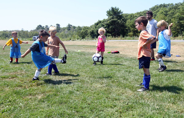 Gloucester: From left: Peter Giordano, Noah Willett, Ben Andrew, Julia Ward, Will Andrew, and Mac Trotman work on passing to an open space while working with coach Chris Ahearn during the North Shore United Soccer Clinic at Magnolia Woods yesterday. The clinic, which is for kids age 6-14, runs all week. Photo by Kate Glass/Gloucester Daily Times