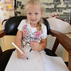 Gloucester: Hannah Sherlock 4, sits and draws, while waiting for her mom Bethany to drop off her two brothers and help out on the first day of school, at Veterans Memorial School on Webster St. Hannah will be joining her brothers next year as a kindergartner. Desi Smith /Gloucester Daily Times. August 31,2011<br /> &#x13;, Gloucester: Hannah Sherlock 4, sits and draws, while waiting for her mom Bethany to drop off her two brothers and help out on the first day of school, at Veterans Memorial School on Webster St. Hannah will be joining her brothers next year as a kindergartner. Desi Smith /Gloucester Daily Times. August 31,2011<br /> &#x13;
