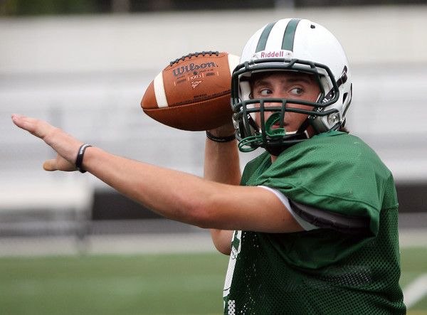David Le/Gloucester Daily Times. Manchester-Essex junior quarterback Cory Burnham keeps his eyes on his target during practice on Thursday afternoon. 8/25/11.