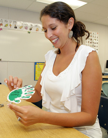 Jaclyn Baldassano, a Kindergarten teacher at Beeman Memorial makes a ring of nametags for her students on Tuesday afternoon in preparation for the first day of school on Wednesday. David Le/Gloucester Daily Times