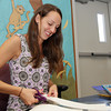 Jenna Murphy, a first grade teacher at Beeman Memorial cuts out lamenated name tags before the start of school tomorrow. David Le/Gloucester Daily Times