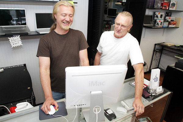David Le/Gloucester Daily Times. Good friends Thad Bernard, left, and Frank Bernardini, both of Rockport, started a business to fix and troubleshoot Mac and PC computers. Their business, Mac Daddy and Abacus, is located on Main St. in downtown Gloucester. 8/15/11.